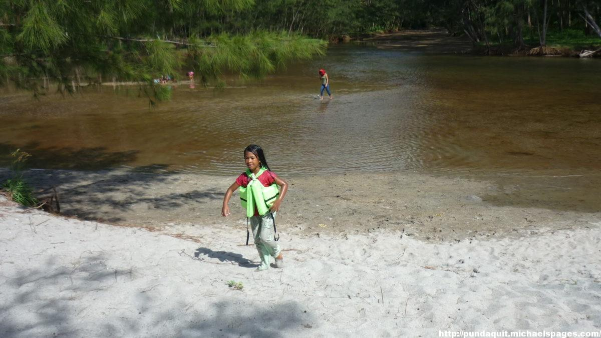 Anawangin - children are playing in the shallow water of the river