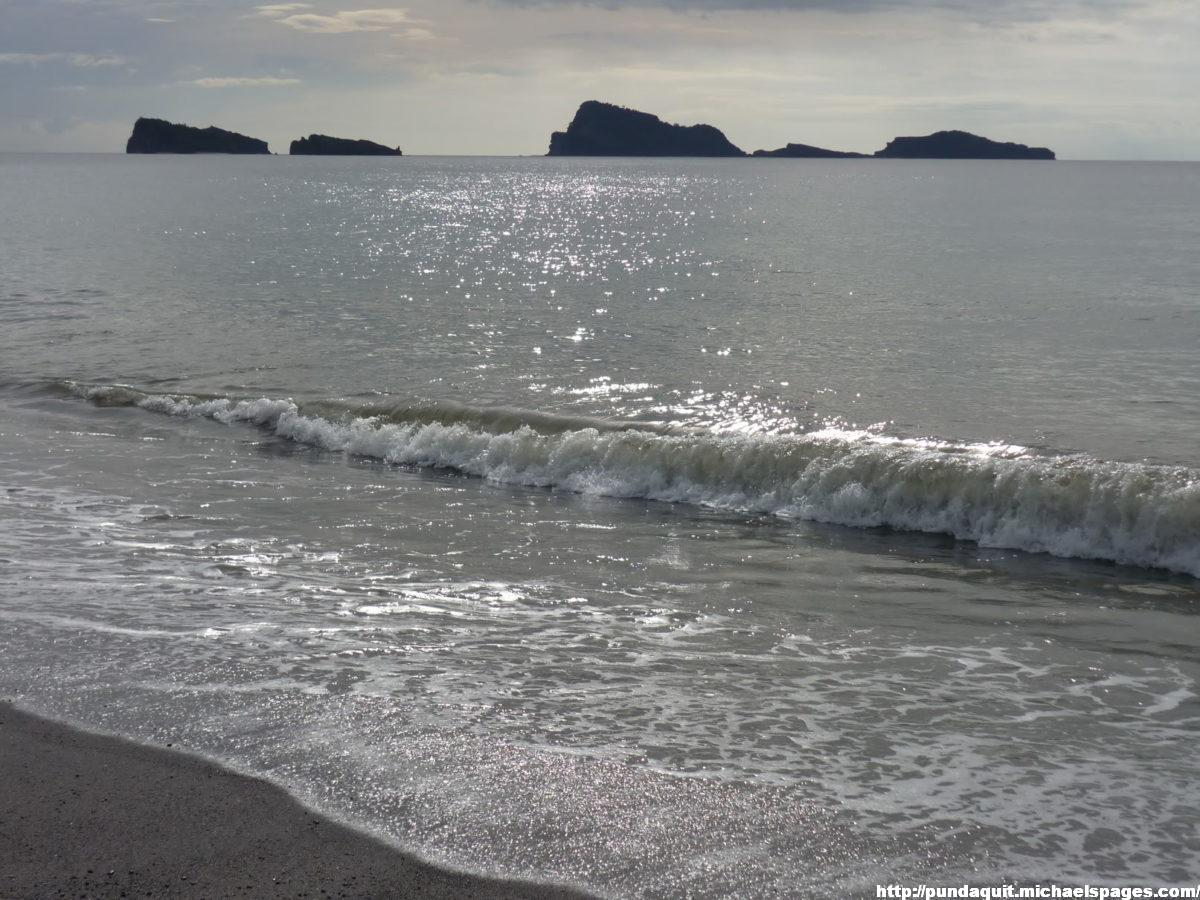 the beach with visible Camara and Capones Island
