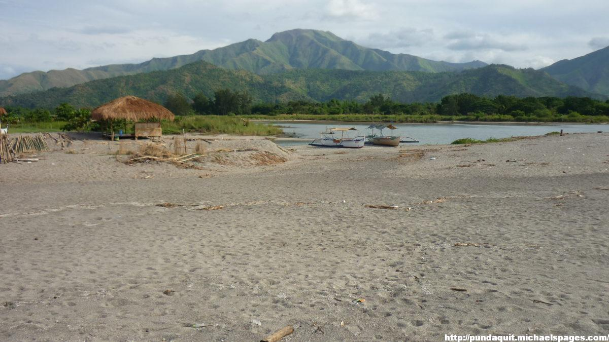 Pamatawan river visible from the beach and mountains farther